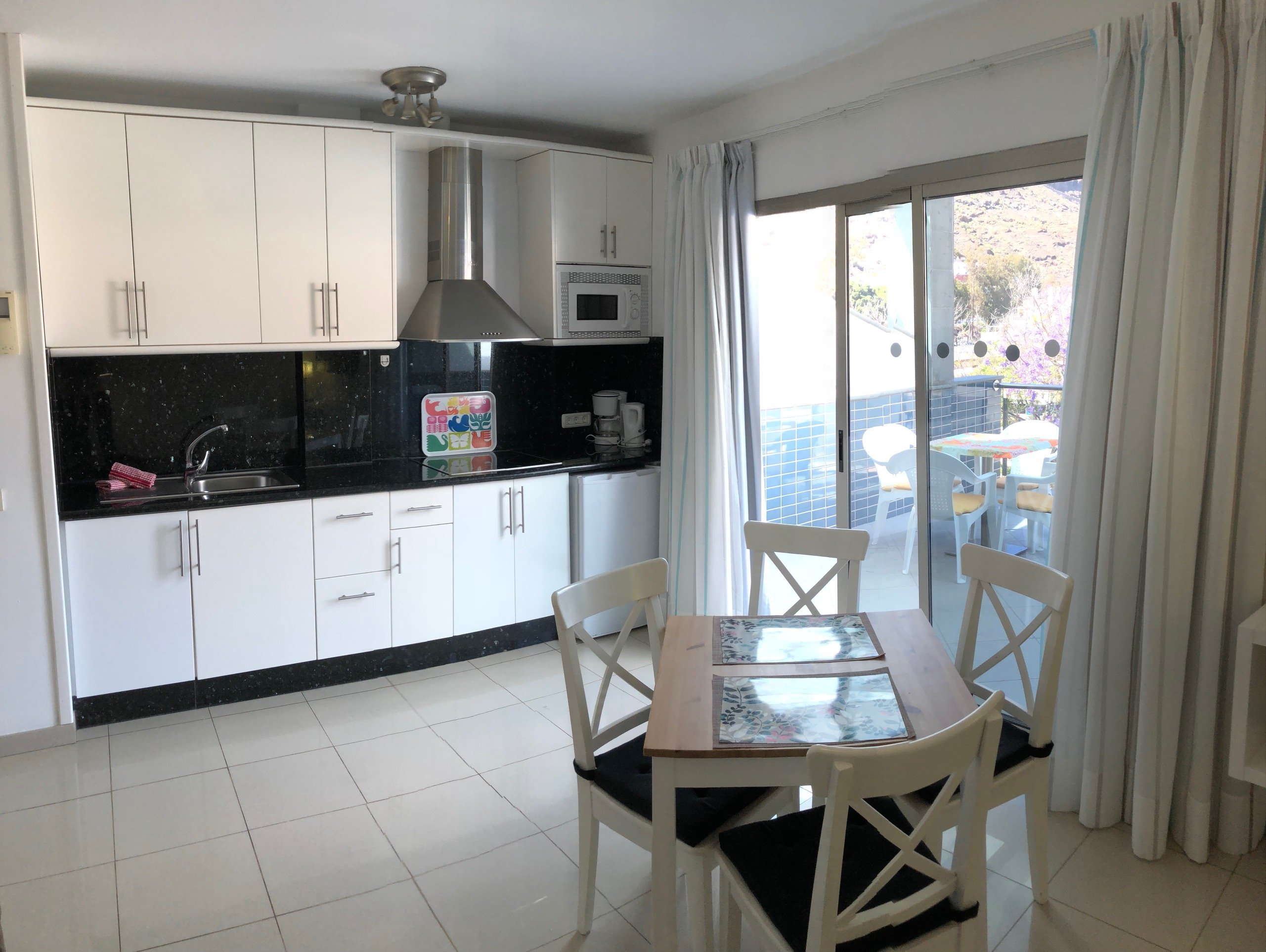 One bedroom beachfront with terrace and a mountain view luxury holiday apartments puerto de mog n for Mountain view 2 bedroom apartments